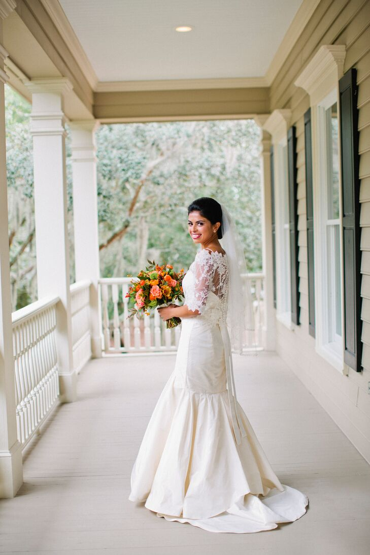 Amanda donned a striking fit-and-flair gown with a small train. She accessorized the dress with a lace bolero that she wore for the Catholic Mass ceremony and then removed at the reception.