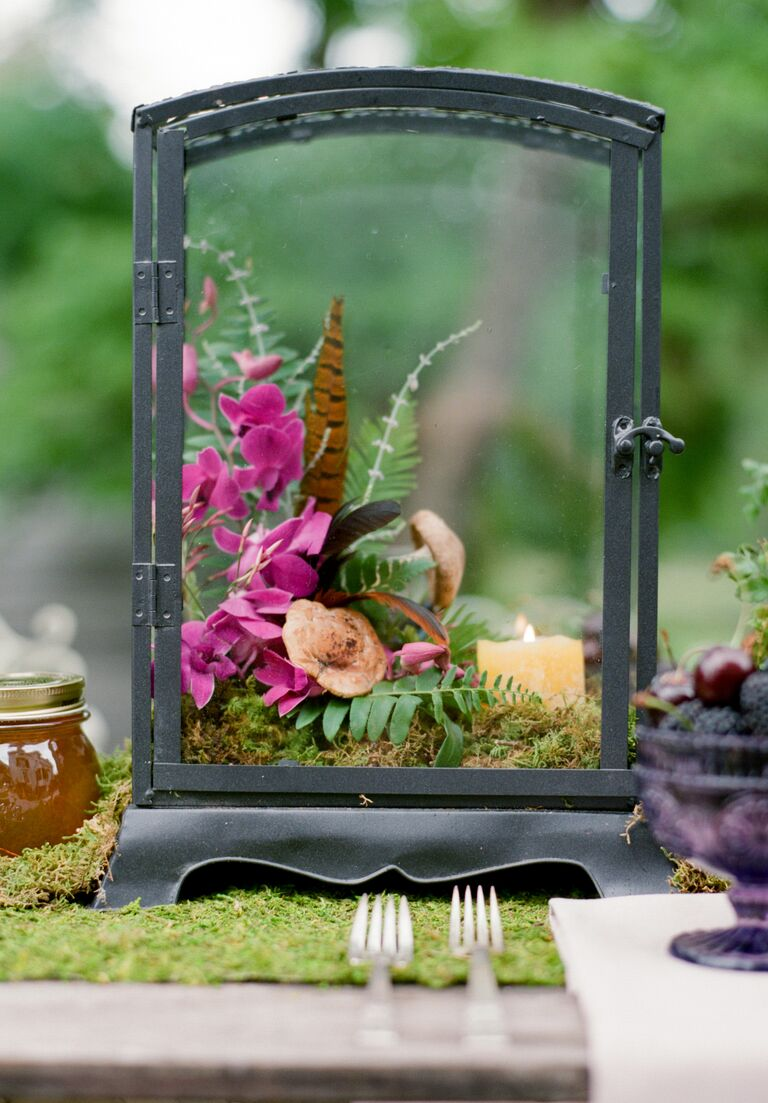 Terrarium and feather wedding centerpiece