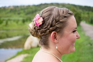 Braided Updo Hairstyle With Pink Flowers