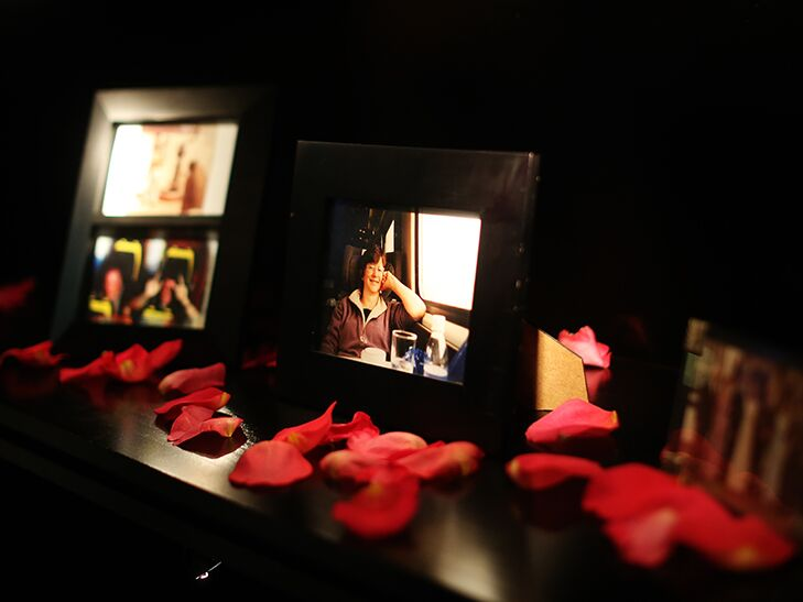 photographs in memory of family members as wedding ceremony decor