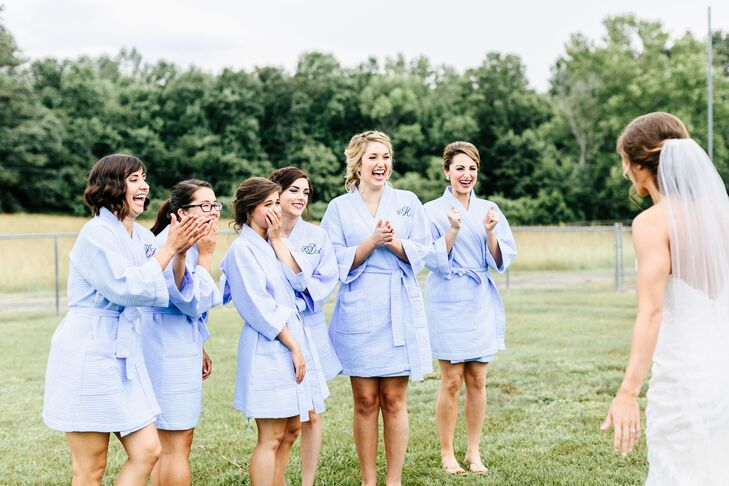 In addition to a first look with the father of the bride, Rachel provided bridesmaids with a peek of her lace wedding dress before the ceremony.