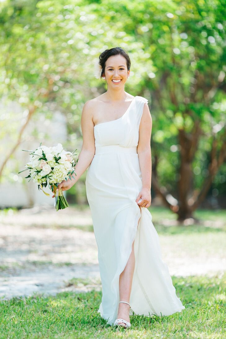 """I was so in love with my wedding dress. I ended up choosing a bridesmaid dress that happened to come in ivory,"" Kay says. ""I knew I wanted something with a straight silhouette, since a ball gown dress isn't exactly my style and isn't practical for a Florida wedding. When my mom pointed it out on the rack, I was skeptical, but she insisted I try it on. Once I saw myself in the mirror, I knew it was the one. Mom always knows best!"" The simple silhouette and lightweight fabric of the dress made it perfect for the couple's beach wedding in the Florida Keys."
