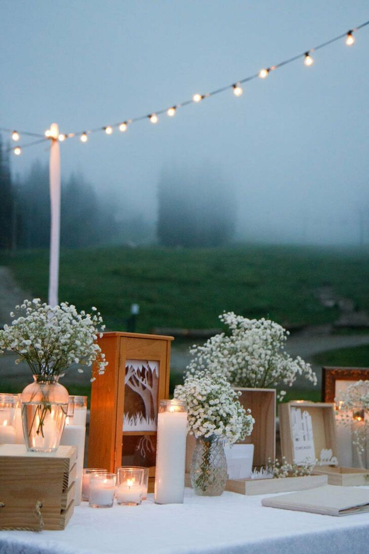 Mismatching vases, various candles and bouquets of baby's breath made up much of the reception's decor.