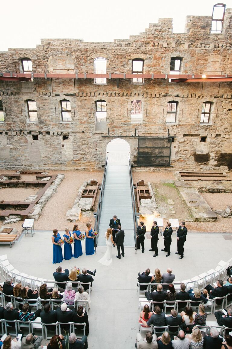 Wedding ceremony with industrial ruins as the backdrop