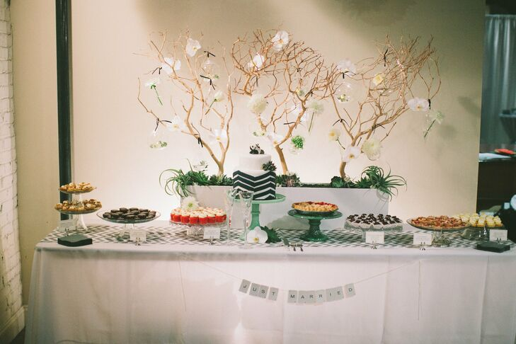 The couple wanted to serve a variety of desserts to their guests. In addition to a cutting cake, the dessert table featured pies, tartlets and cupcakes.