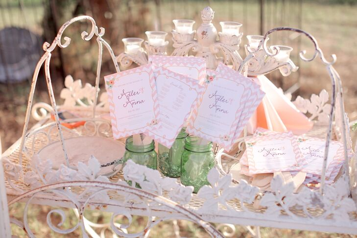 Anna and Adler's blush chevron ceremony programs doubled as fans, so their guests could stay cool in the Texas outdoors.