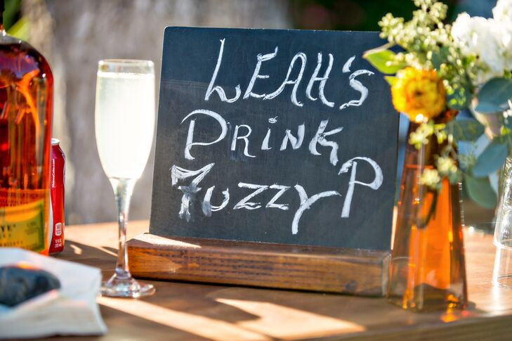 "Two signature cocktails were served in addition to the full bar. The bride's custom cocktail was called a ""Fuzzy-P,"" and was a lighter peach flavored vodka option."