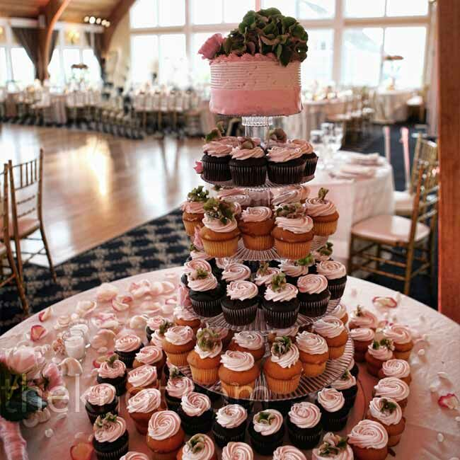 Vanilla and chocolate cupcakes filled out five of the six tiers in the tower. The couple cut into a small, pink cake which sat on top.