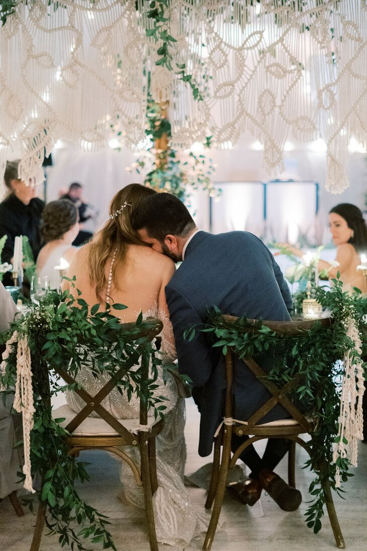 Whimsical Cross-Back Sweetheart Chairs with Greenery