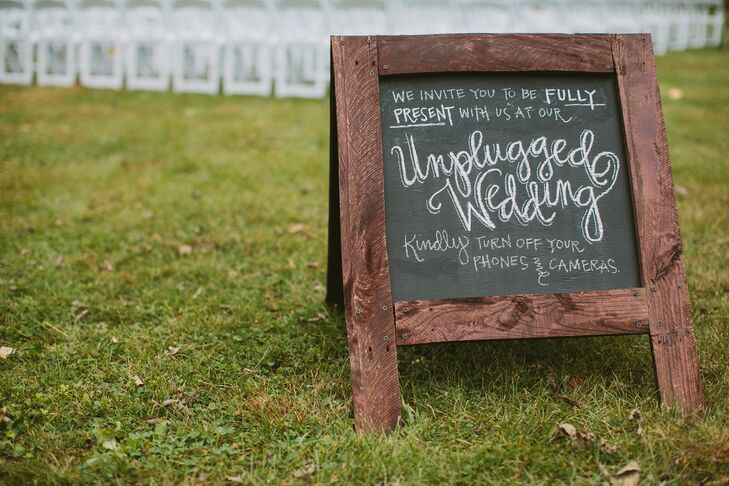 The couple decided to go off-the-grid for their ceremony to keep the focus fully on the sentiment of the event. They placed a rustic wooden sign at the entrance to the ceremony space asking guests to turn off their phones and cameras during the proceedings.