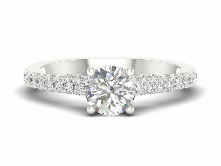 Jenny Packham round diamond engagement ring in solitaire setting with diamond pave band