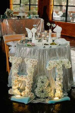 Flower-Covered Initials at Silver Sweetheart Table