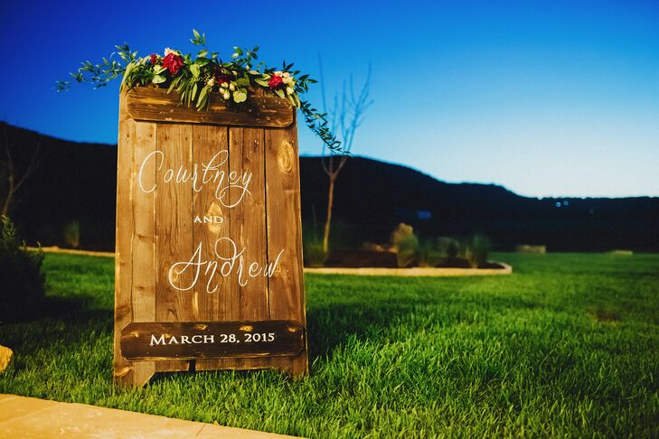 Courtney and Andrew wanted to play off the natural beauty and rustic features of Bella Springs Events, so they commissioned several wooden signs. The signs were stained a rich, dark brown color and rubbed with gold for a glam touch. White calligraphy and florals added a whimsical feel.
