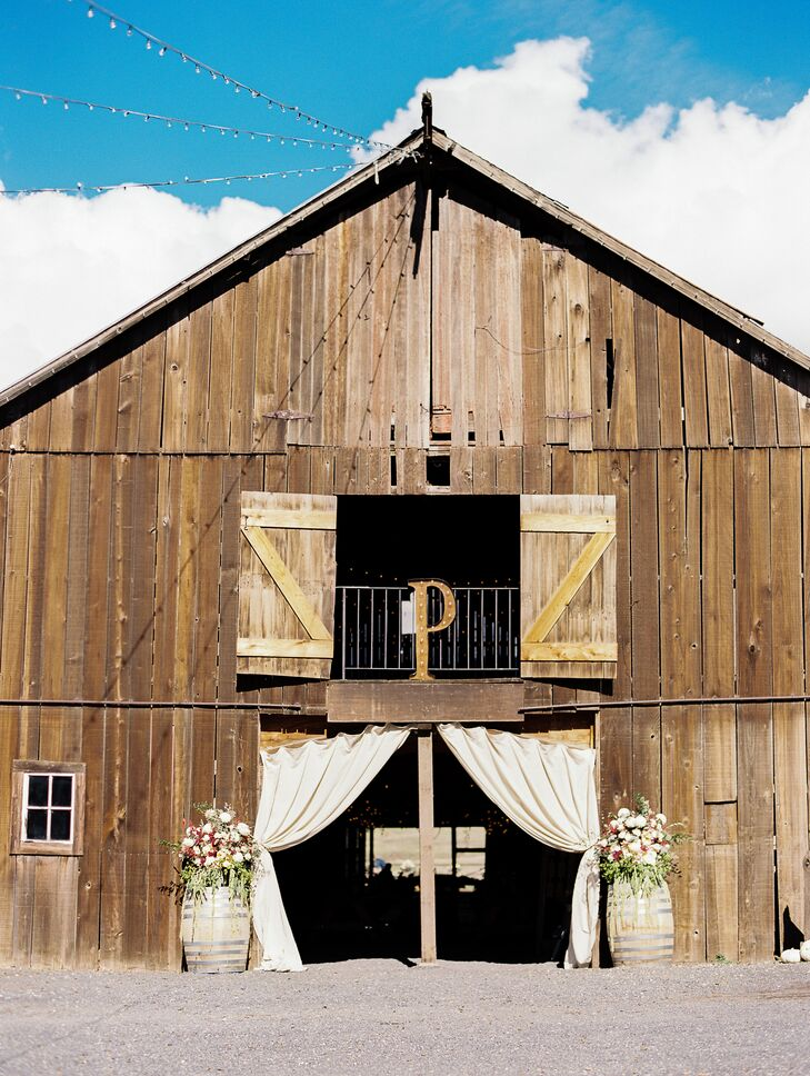 """With worries of rain, moved our reception inside the barn, and it was a great decision,"" Julie says. ""Bringing in picnic tables and softening them up with eucalyptus garlands created a space that was perfectly intimate and cozy with lots of charm."""