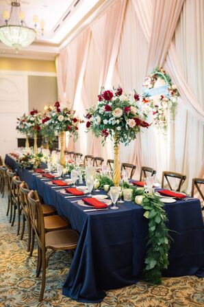 Table with Navy and Red Linens and a Garland Runner
