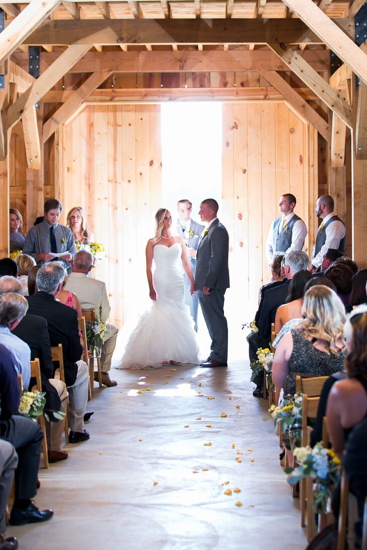 The ceremony took place inside the barn at  Amador Cellars in Plymouth, California, with minimal decor for an all-natural look. Lauren and Drake stood in front of the barn doors, with a slight gap letting in light to illuminate the space.