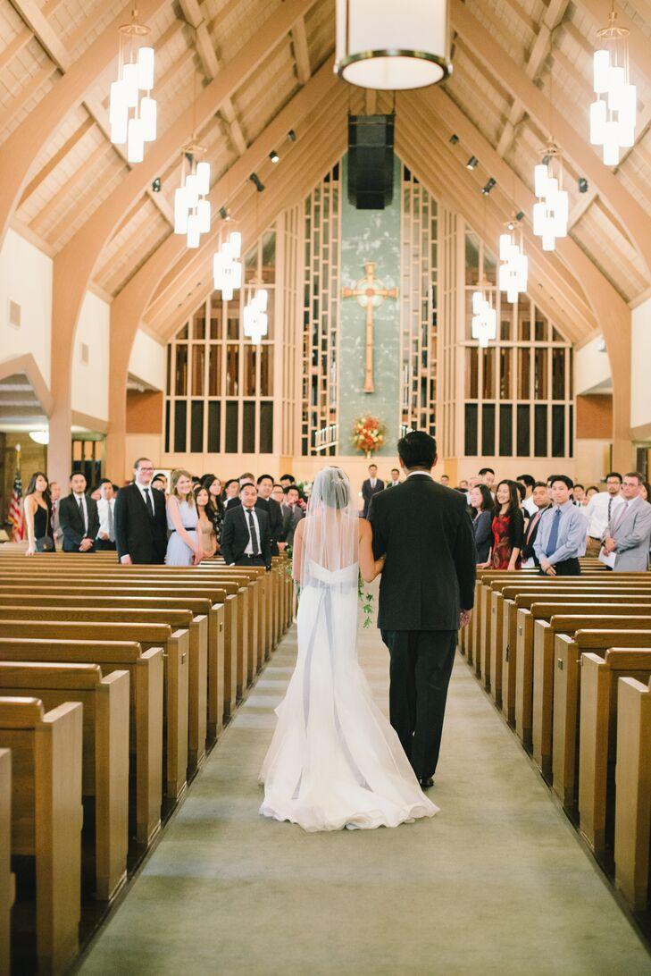 "Jauchy and Jeff said their vows at the Presbyterian Church of Los Gatos. ""We happened to drive by one day and stopped on a whim to take a peek,"" Jauchy says. ""We immediately fell in love with the high vaulted ceilings, the organ pipes, the stained-glass windows and all the natural light that was pouring in."""