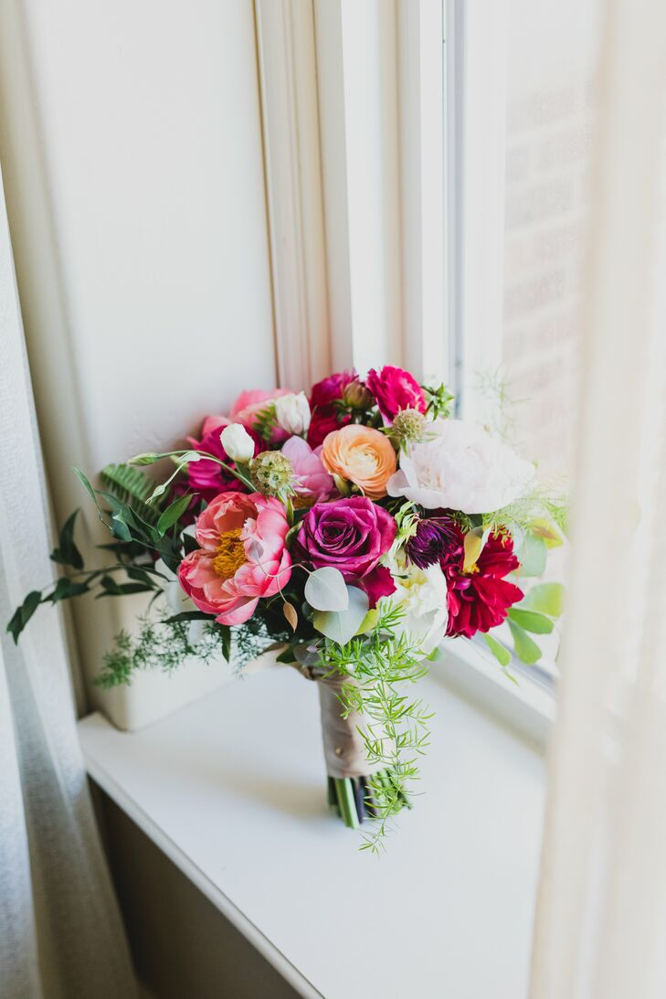 "Erin Blackwood and Justin Baier's intimate rooftop wedding was filled with playful, rustic details and pops of vibrant color. ""We have family spread a"