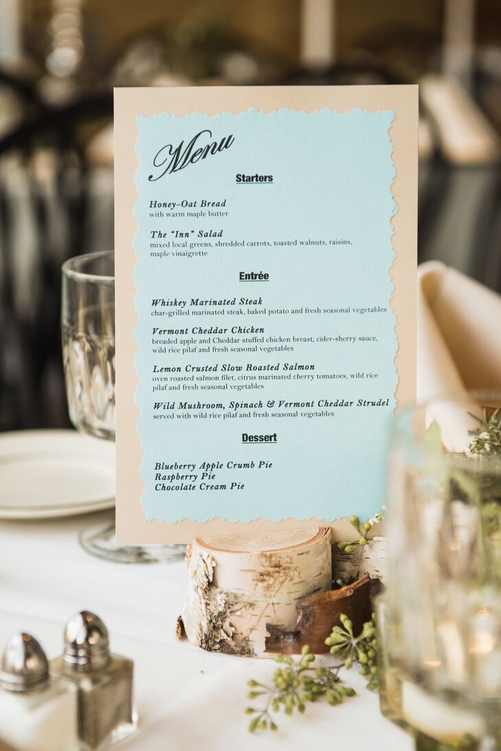 The rustic DIY blue-and-ivory menu cards were done by a bridesmaid's businesses, Bird and Buffalo. To match the natural feel of the wedding, the centerpieces included birch-tree branches and seeded eucalyptus.