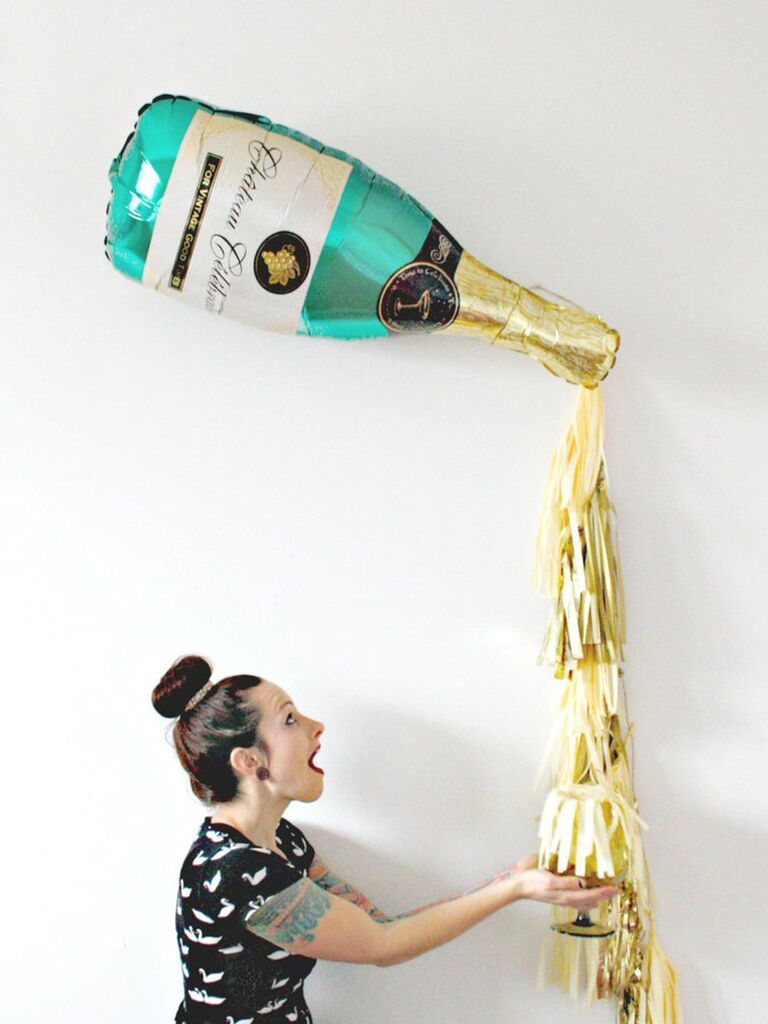 Giant champagne and tassel ballon for bridal shower or bachelorette party decor