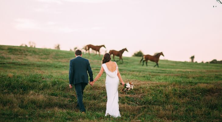 After the ceremony, the newlyweds took a stroll through the pasture at Riverside on the Potomac. Molly's dress featured a beautiful cowl back.