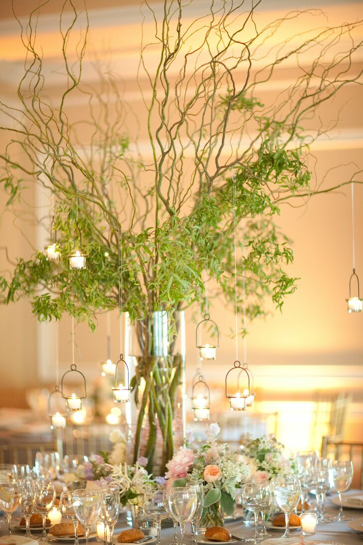 Lush green vines decorated with hanging votive candles added a touch of whimsy to the receptions and cast romantic glow as the sun began to set.