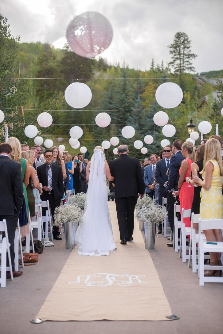 Ashley ordered a monogrammed burlap aisle runner from Etsy and lined the aisle with galvanized tins full of baby's breath.