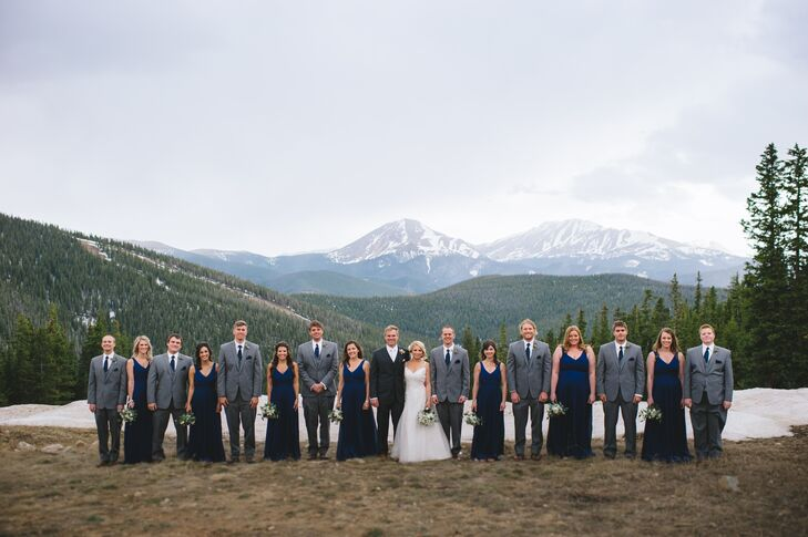 The bridesmaids wore navy floor-length J. Crew dresses and the groomsmen wore gray suits with navy ties.