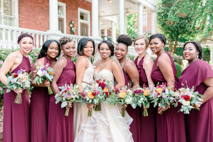 """Kimberlyn's nine bridesmaids wore marsala red floor-length gowns in a variety of styles. """"Each one has a different personality and body type, and I found it unfair and unjust to make them all wear the same dress,"""" she says. """"I wanted them to be comfortable and enjoy the wedding without complaints of an ugly or tight-fitting dress."""""""