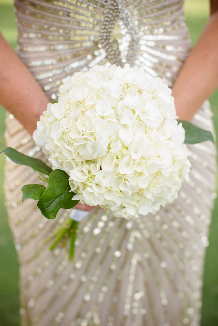 The bridesmaids carried small bouquets of white hydrangeas for a simple, classic look.