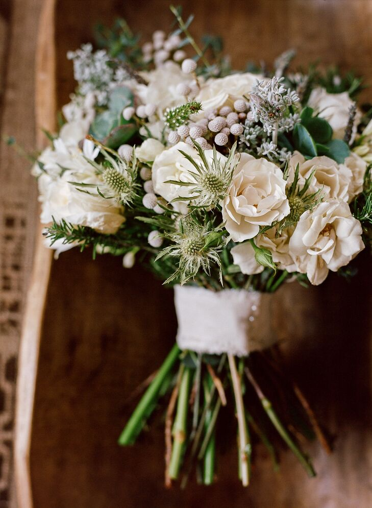 "Charlotte requested that her bouquet stay with neutral colors and greenery and incorporate white hydrangeas and succulents. ""Given that it was a winter wedding, that seemed more appropriate and was in line with our overall theme of rustic, mountain-chic,"" she says of her vision."