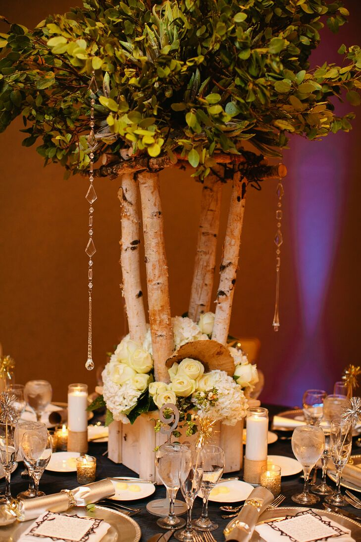 Tall centerpieces made from birch tree branches and greens were surrounded by small bunches of hydrangeas, roses, mums and sweetheart roses.