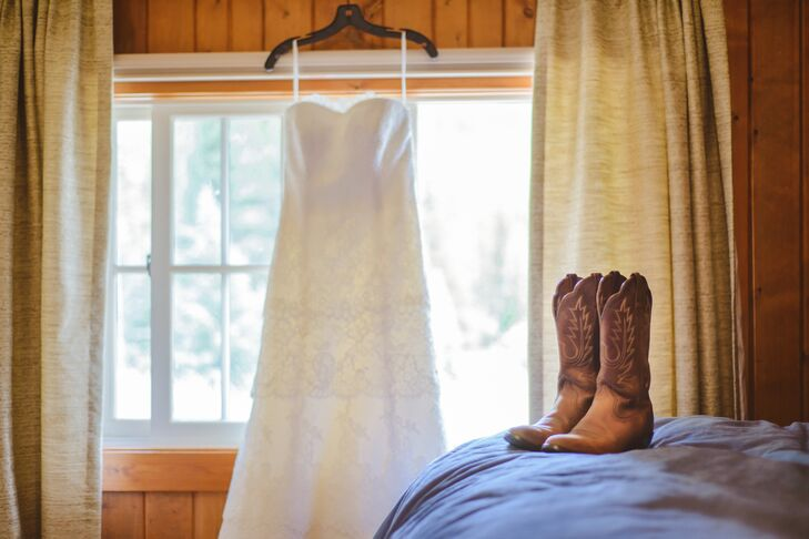 Sasha bought her lace Augusta Jones dress at Anna Be Bridal Boutique.  She paired the dress with cowboy boots for a country-chic look.