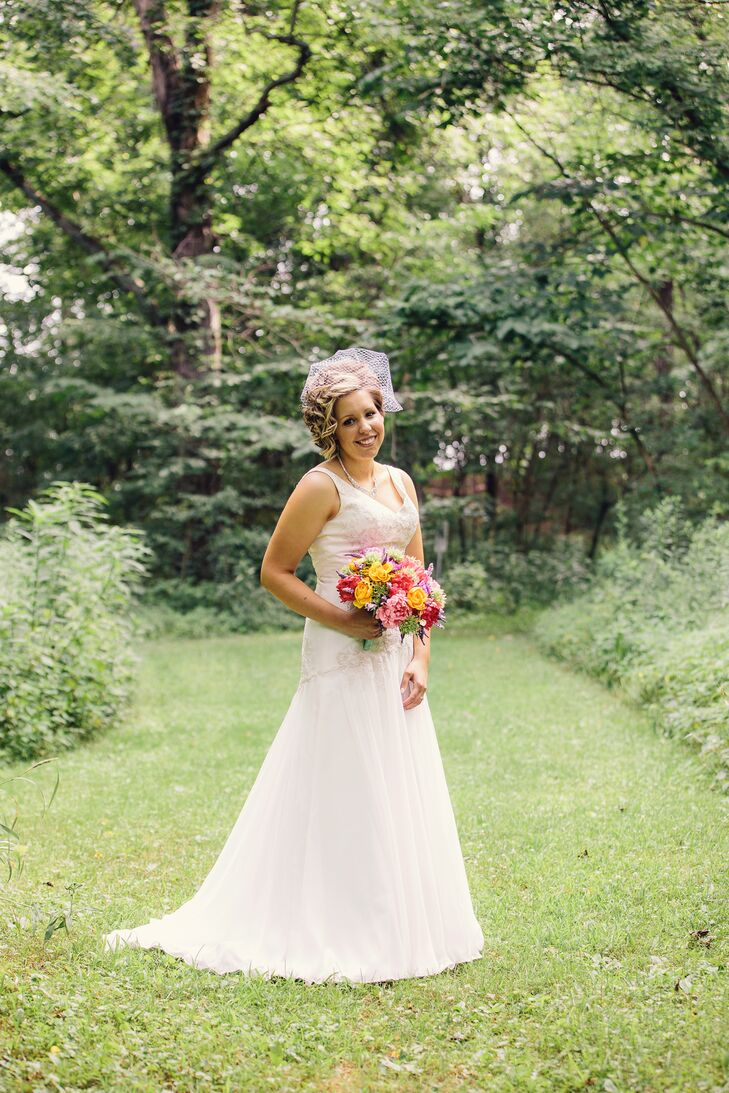 """Jodi donned an A-line dress with lace and sequin detailing on the top and chiffon on the bottom. """"I walked into David's Bridal, saw a dress up on the wall on a mannequin, and said, 'That's the one I want,'"""" she says."""