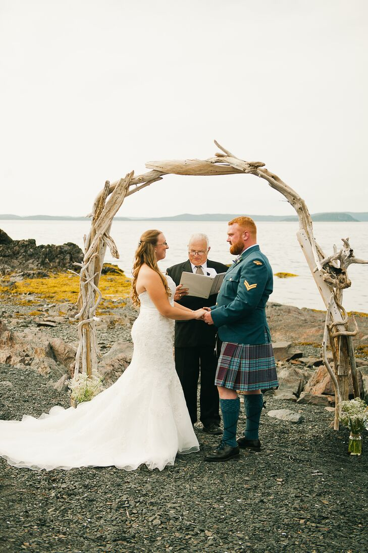 The couple exchanged their vows underneath an arch made from old driftwood.