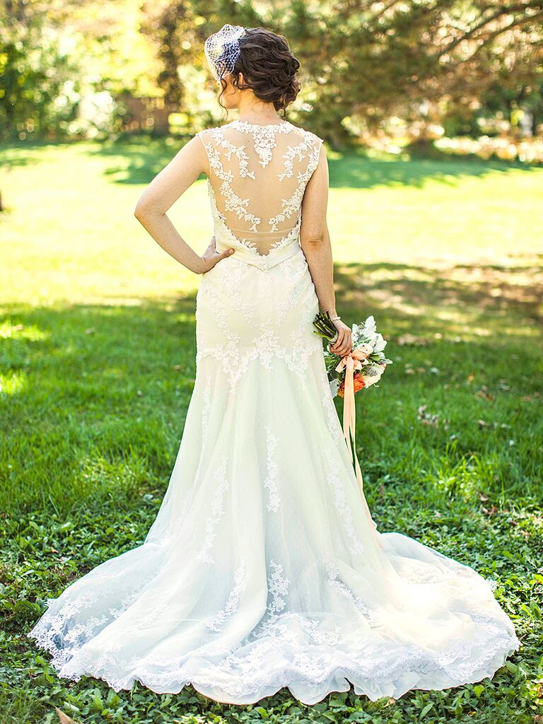 Fitted wedding gown by Pronovias with sheer lace details