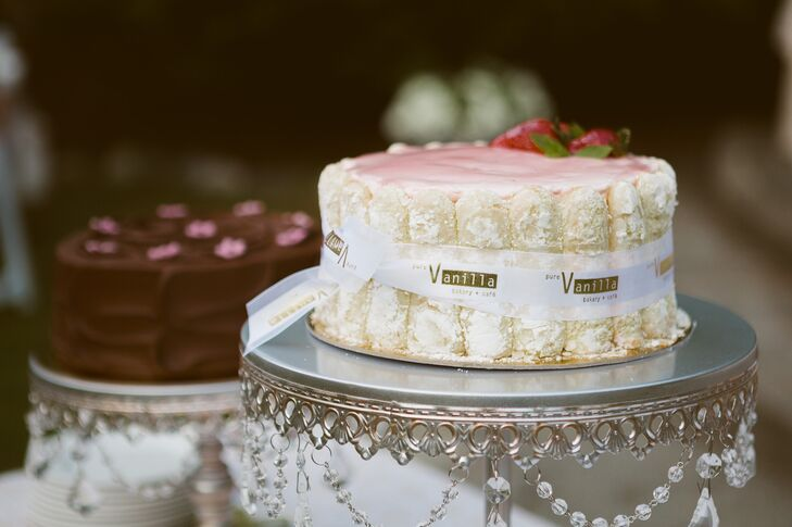 The single-layer ladyfinger strawberry cake was displayed on an antique silver cake stand.