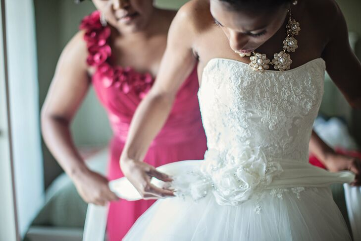 Talitha wore a classic ivory tulle and lace Sottero & Midgley ball gown.  A silk taffeta belt, with floral and Swarovski crystal adornments, was attached at the waist of the gown.