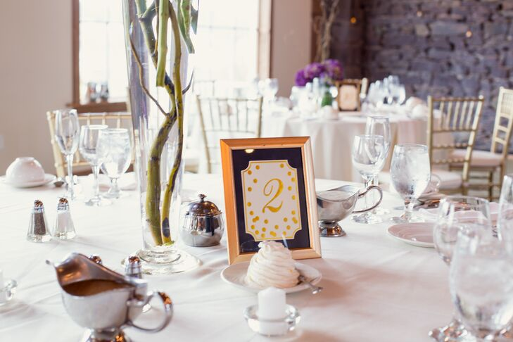 Wanting simple and formal stationery throughout their wedding, each table at Sarah and Matt's wedding was accented with a gold and purple table number. Gold frames were paired with a gold dotted design surrounding the number for a fun touch. With a whimsical hydrangea centerpiece on each table, the numbers added a welcome, simpler touch.