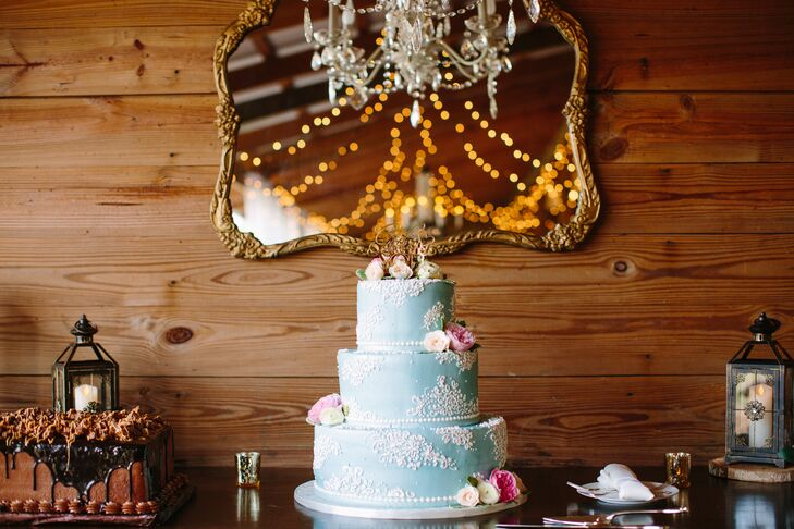 The pale blue three-tier wedding cake by Alessi Bakery was flavored vanilla with custard filling.