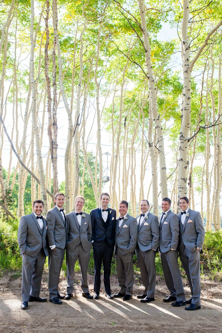 Brett wore a two-tone black tuxedo and his groomsmen wore gray tuxedos for a softer look. They all wore black bow ties and blush pocket squares.