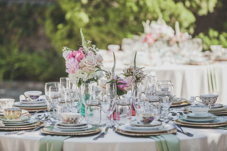 Mismatched vintage china, glasses and mason jars, along with small arrangements of pastel pink and white roses, peonies and hydrangeas, added a whimsical touch to the table decor.