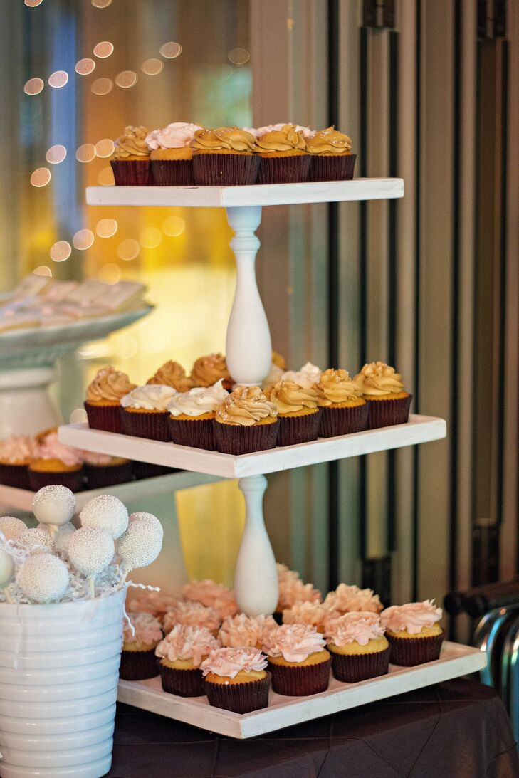 Instead of a wedding cake, Katie and Rob served their guests an assortment of cupcakes arranged on a tier stand. They also served cake pops and other desserts.