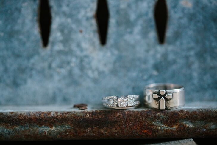 """Dustyn proposed to Katie with a beautiful round-cut diamond ring in a diamond-embellished setting. Katie created a custom-made ring for Dustyn that incorporated their love of God. """"Dustyn told me he wanted a ring with a cross on it, and I ended up having a local silversmith make his ring from scratch,"""" Katie says. """"I also bought a Bible for Dustyn as a wedding gift and had the silversmith incorporate the same-style cross from his ring on the cover of the Bible, along with a silver nameplate on the bottom."""""""