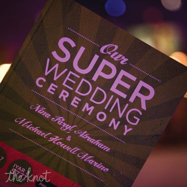 The couple wanted their invitations to be unique, interactive and fun so they met with designer friend, Jessica Koffman, to brainstorm and decided to make a very short choose your own adventure  story. The story was of 2 superheros, superboy & supergirl, that had everything in the world they ever wanted except for a sidekick. Of course the superheros meet and plan to marry. At the end of story and booklet, the guests get to choose if they would like to attend the wedding or not.
