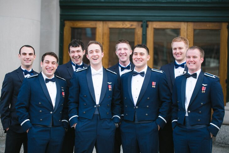 rnMatthew, an Air Force pilot, decided to don his formal mess uniform for the wedding, pairing it with a classic white bow tie. Three of his other groomsmen, also Air Force officers sported similar styles, while the remaining four wore navy Michael Kors suits with tuxedo shirts and navy bow ties to complement the Air Force uniforms.