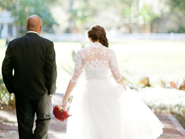 Groom and bride with red bouquet