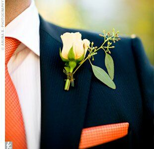 Jerome wore an orange rose boutonniere to coordinate with his orange tie and Lara's bouquet.