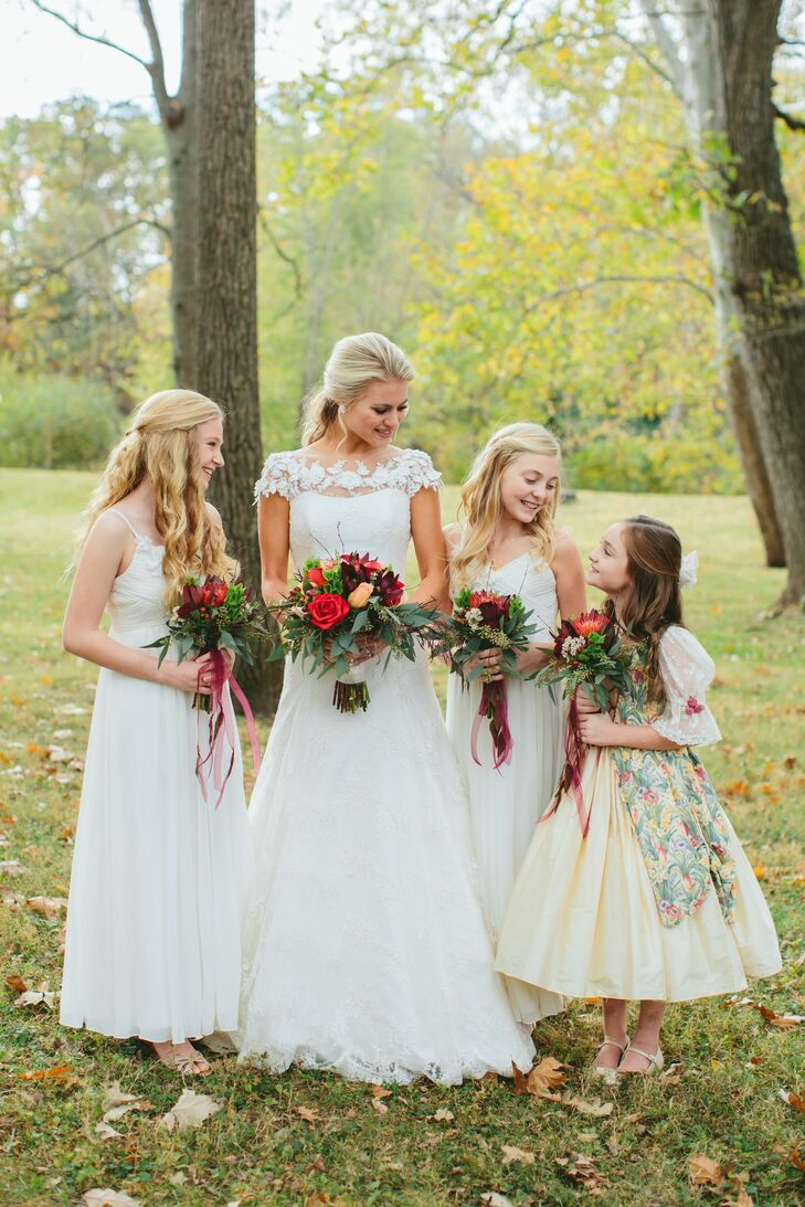 Other important members of the bridal party, including Gail's younger sister who was a flower girl, carried smaller bouquets of fall-colored flowers and cascading greens.
