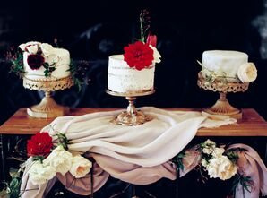 Elegant Trio of Wedding Cakes on Gold Stands